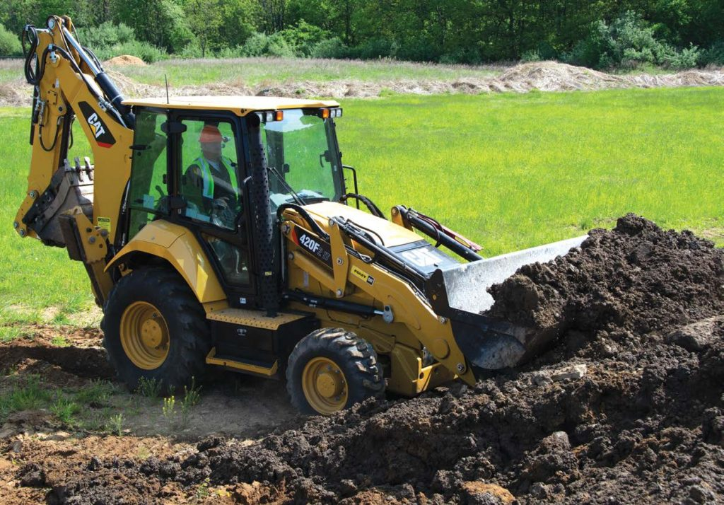 Going Solo: Attachments Enable Backhoe Loader To Do Work Of