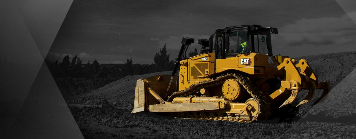 A D6 Cat dozer in color in a black-and-white setting